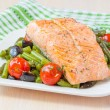 Fillet of red fish salmon with green beans, tomatoes and black o — Stock Photo #39683001