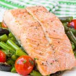 Fillet of red fish salmon with green beans, tomatoes and black o — Stock Photo #39683005