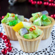 Stock Photo: Salad tartar with herring, avocado, lettuce in tartlet, canapes
