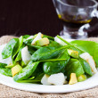 Green salad with spinach, white fish and avocado, dietary food — Stock Photo #39683795