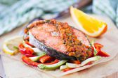 Steak red fish salmon on vegetables, zucchini and paprika with s — Stock Photo