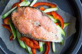Cooking steak of red fish salmon on vegetables, zucchini, sweet — Stock Photo