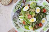 Healthy quinoa salad with tomatoes, avocados, eggs, herbs, lettu — Stock Photo