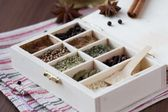 Assortment collection of spices and herb in wooden box, food bac — Stock Photo