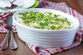 Rice casserole with egg, green spring onions, cilantro, chili, a — Stock Photo