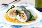 Fish rolls of dorado fillet stuffed shrimp and spinach with onio — Stock Photo