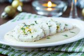 Roulade roll of white fish fillet cod stuffed with egg, sauce be — Zdjęcie stockowe