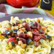 Постер, плакат: Italian pasta orecchiette with stew of vegetables and beans del