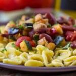 Постер, плакат: Italian pasta orecchiette with stew of vegetables and beans del