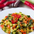Fried vegetables cubes, Ratatouille, zucchini, red pepper, delic — Stock Photo #44126671