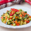 Постер, плакат: Fried vegetables cubes Ratatouille zucchini red pepper delic