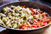 Cooking stew ratatouille from vegetables in frying pan, deliciou — Stock Photo
