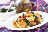 Fried potato gnocchi with sauce of dried tomatoes, spinach, Ital — Stock Photo