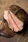 Piece of roasted beef, veal, cut in slices, delicious homemade d — Stock Photo