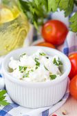 White soft cheese, feta, goat in bowl with tomatoes, parsley, ol — Stock Photo