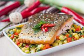 Fried fillet of red fish salmon with crispy skin, roasted vegeta — Stock Photo