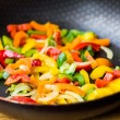 Mixed colorful peppers paprica fried in pan — Stock Photo #46092169