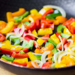 Mixed colorful peppers paprica fried in pan — Stock Photo #46092173