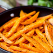 Sweet potatoes, batata, sliced, fried in pan with spices, herb — Stock Photo #46092475