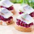 Canape herring with beets on rye toast, appetizer for vodka — Stock Photo #46092605