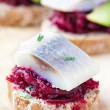Canape herring with beets on rye toast, appetizer for vodka — Stock Photo #46092617