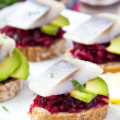 Canape herring with beets on rye toast, appetizer for vodka — Stock Photo #46092619