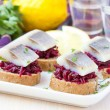Canape herring with beets on rye toast, appetizer for vodka — Stock Photo #46092625