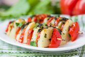Potato vegetarian kebab, skewer with vegetables, tomato, herb on — Stock Photo
