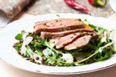 Salad with grilled beef steak, black lentils, rocket, radish, cu — Stock Photo