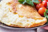 Rolled airy light french omelet with tomato — Stock Photo