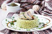 Couscous with pesto sauce, fried sliced pork, tasty dish — Stock Photo