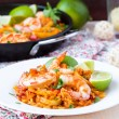 Spanish dish paella with seafood, shrimps, squid, rice, saffron — Stock Photo #48793083