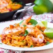 Постер, плакат: Spanish dish paella with seafood shrimps squid rice saffron