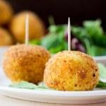 Italian appetizer arancini, rice balls stuffed with meat in oil — Stock Photo #48793111