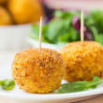 Italian appetizer arancini, rice balls stuffed with meat in oil — Stock Photo #48793113