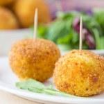 Italian appetizer arancini, rice balls stuffed with meat in oil — Stock Photo #48793115