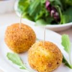 Italian appetizer arancini, rice balls stuffed with meat in oil — Stock Photo #48793131