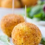 Italian appetizer arancini, rice balls stuffed with meat in oil — Stock Photo #48793133