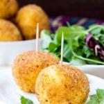 Italian appetizer arancini, rice balls stuffed with meat in oil — Stock Photo #48793145