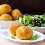 Italian appetizer arancini, rice balls stuffed with meat in oil — Stock Photo #48793151