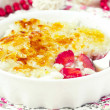 Rice dessert pudding, creme brulee with strawberries — Stock Photo