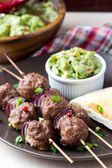 Meat kebab, beef balls on skewer with onions, sauce guacamole — Stock Photo