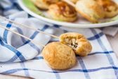 Puff pastry pies with meat filling of chicken on sticks for chil — Stock Photo