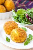 Italian appetizer arancini, rice balls stuffed with meat in oil — Stock Photo