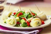 Asian salad with spinach, shrimps, pepper,avocado, rolls squid,  — Stock Photo