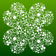 Four leaf clover made from small clover symbols — Stock Vector