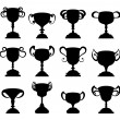 Stock Vector: Trophy cup symbol silhouette set
