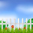 White fence with grass and flowers — Stock Vector #29340305