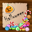 Halloween text frame with candies and pumpkin sticker — Stock Vector