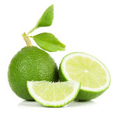 Lime whole and slices — Stock Photo